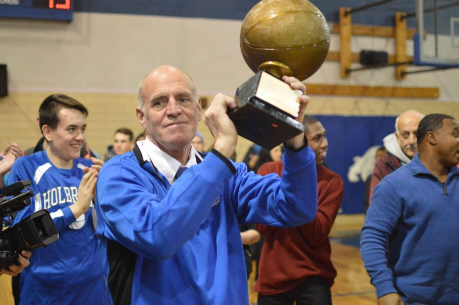 Coach Gifford celebrates receiving the trophy for winning his 400th game.