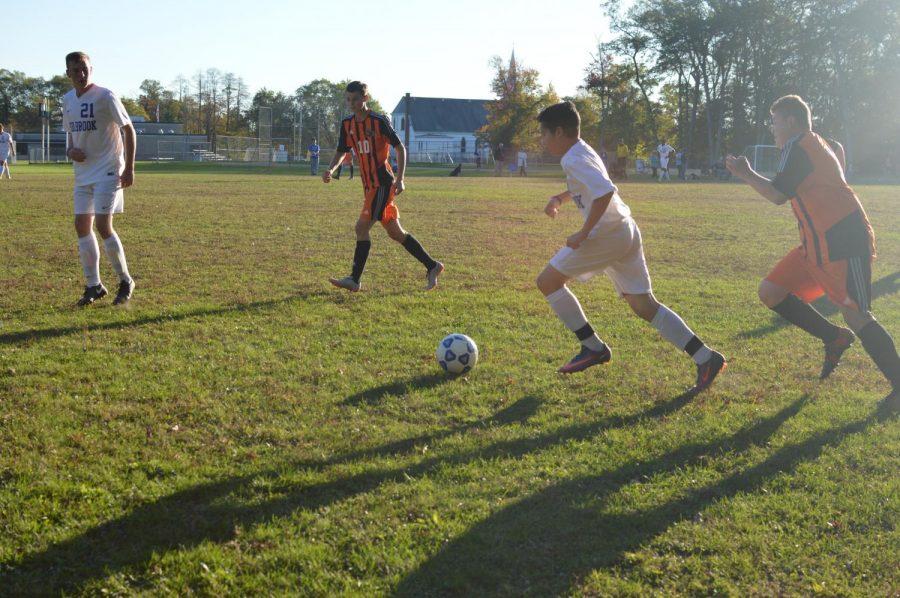 Ayoub ZIad dribbles through the Avon defense