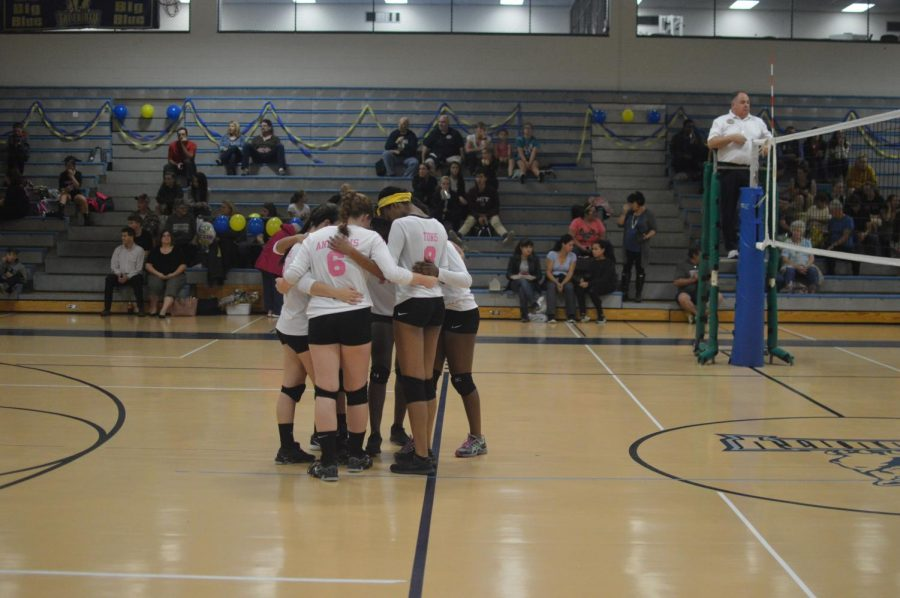 The team huddles after a point