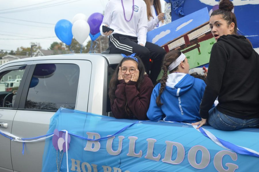 Sophomores Kashly Reyes and Emily Burke ride proudly in their completed float.