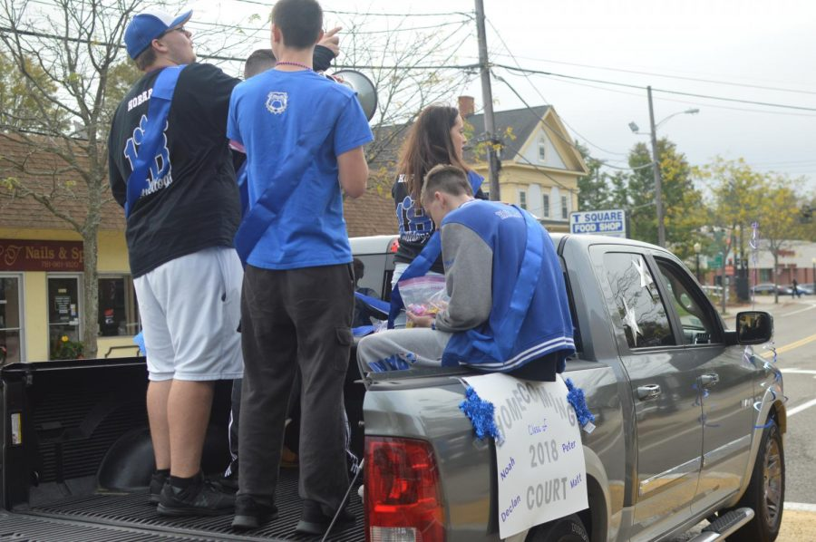 Members of the homecoming court Ashley Koffink, Matt Mullen, Declan Hiltz, and Noah Hobart ride in the back of their float.