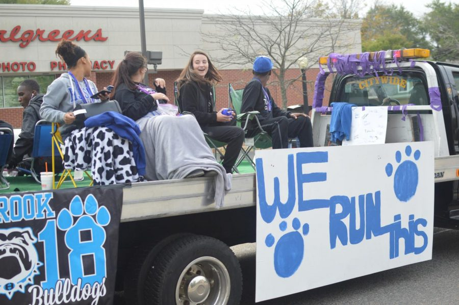 Seniors excitedly turn to the crowd on the senior float