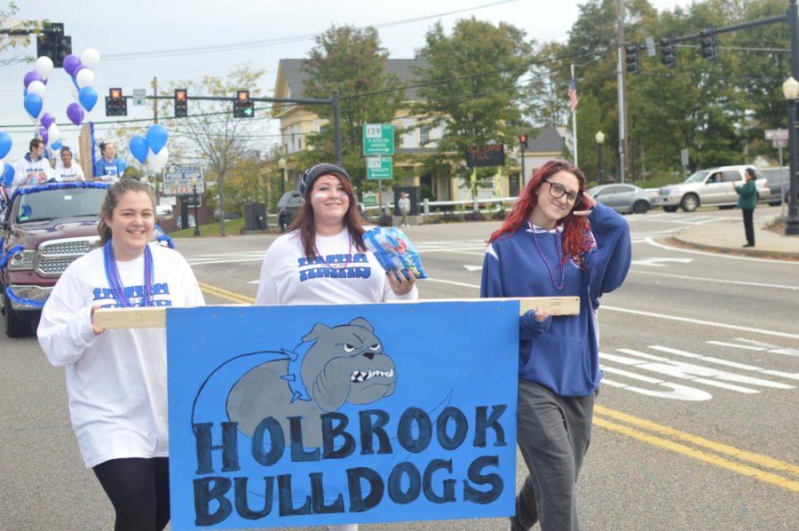 Juniors Kaitlyn Neilson, Amanda West, and Caitlyn Mann lead their float down the street