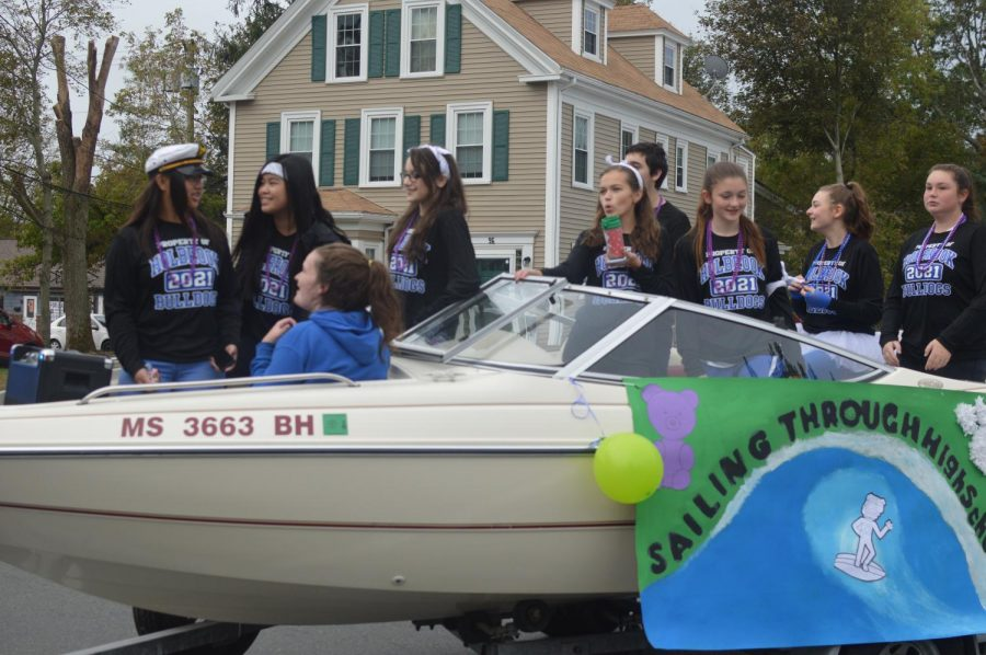 Members of the freshmen class ramp up the crowd looking on at the parade.