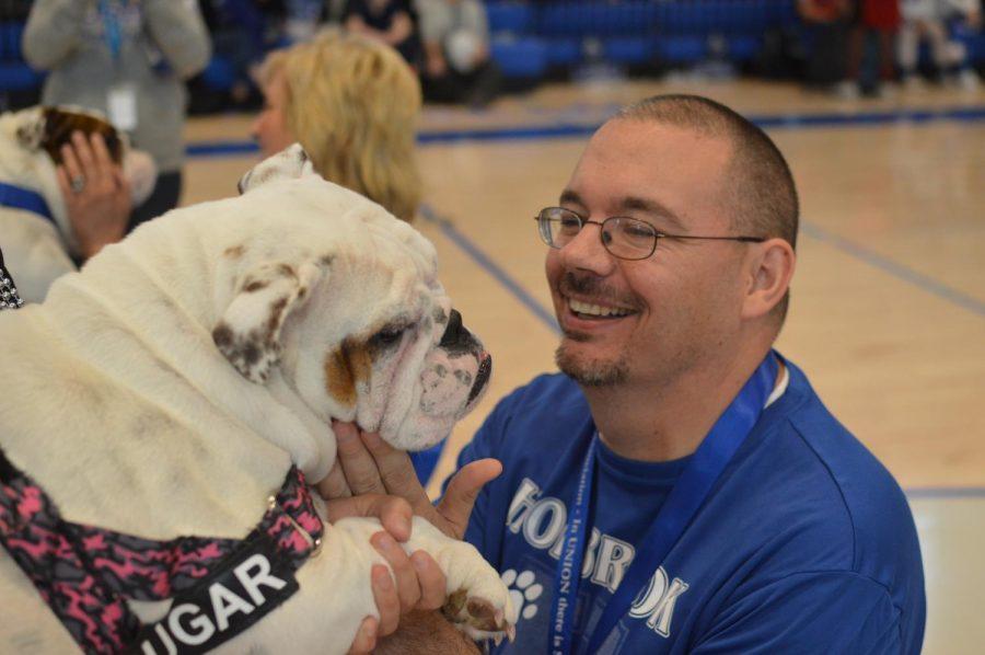 Mr. Jason Welch kisses the bulldog