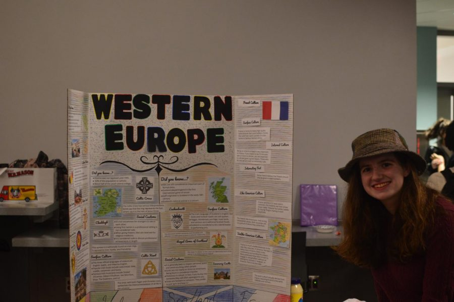 Sarah Ryan posing with her poster of Western Europe.