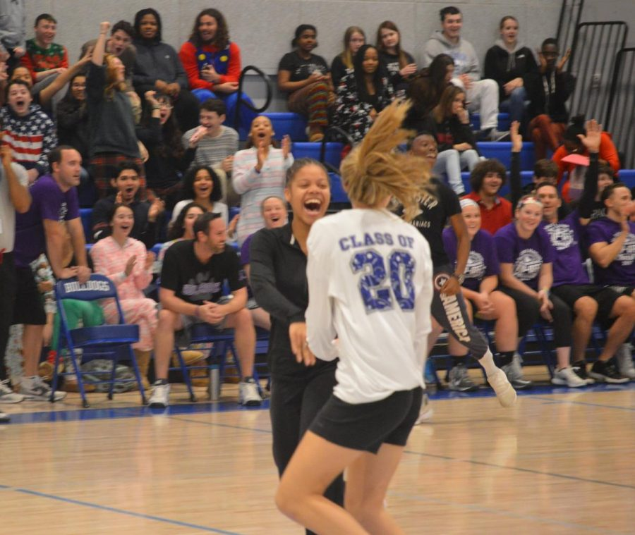 BreAunna White and Riley Cochran celebrate a bucket by the students