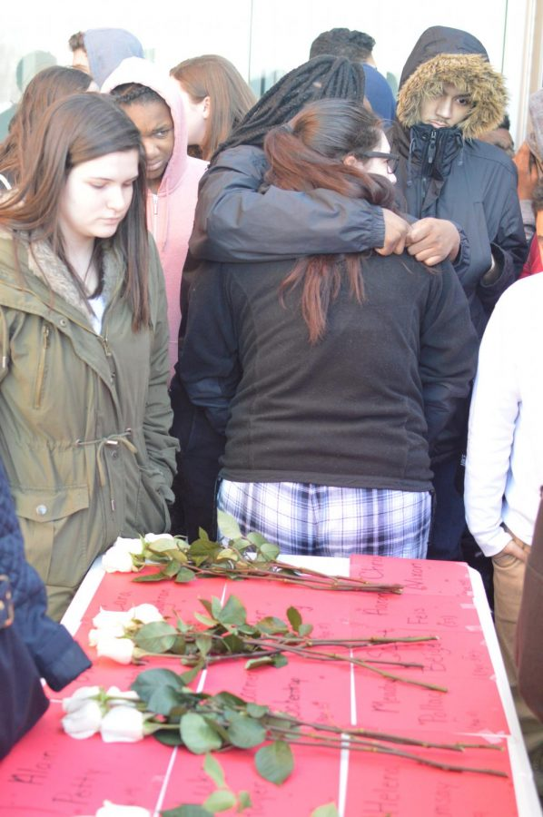 Student embrace during a remembrance of victims