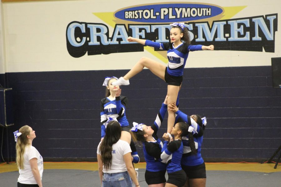 Tiana Docanto holds a lib during their practice run at competition.