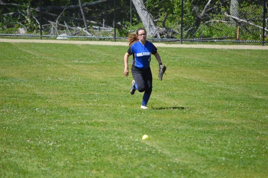 Caroline Duggan chases down a ball in the outfield