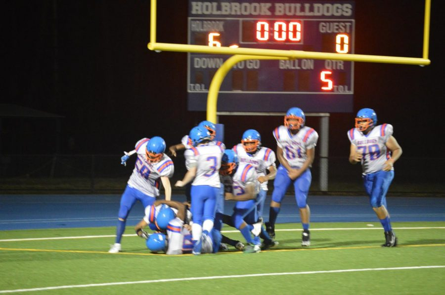 The bulldogs celebrate the game winning touchdown in overtime.