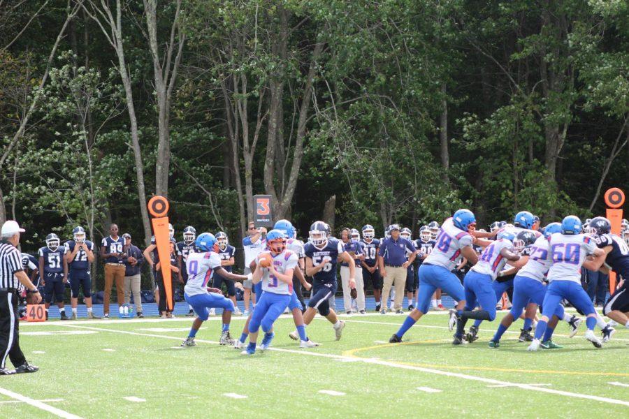 Holbrook-Avon quarterback  Bill Curtis drops back to pass