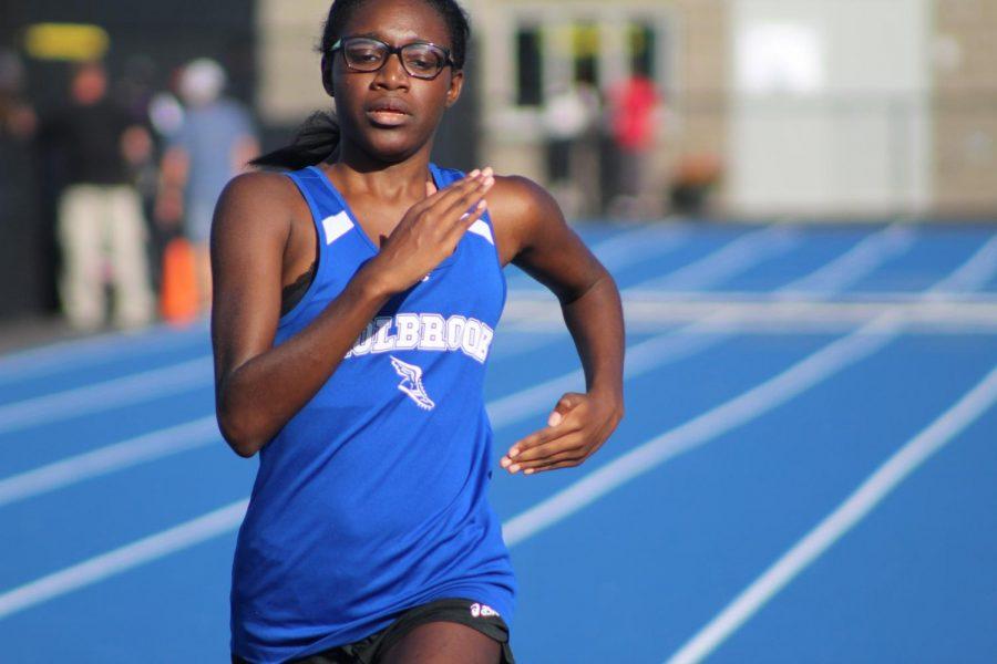 Christine Valcimond as she runs along the track.