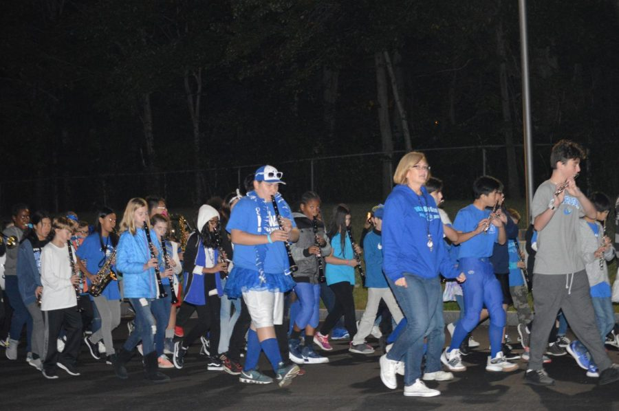 Mrs. Sordillo and Mrs. Laprise conducting the band throughout the entire HMHS during the homecoming parade.