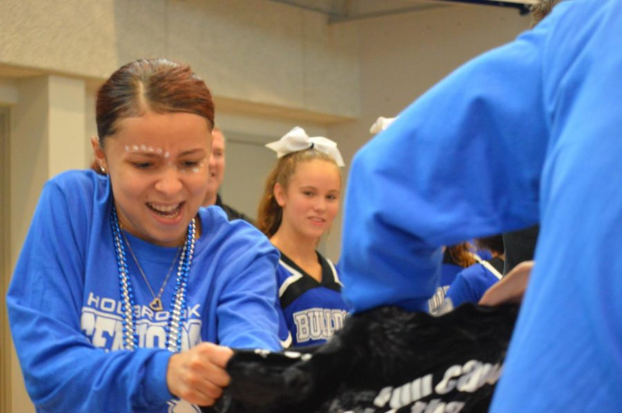 Teachers and students race each other to put on a frozen shirt was one of the fun events at the pep rally.
