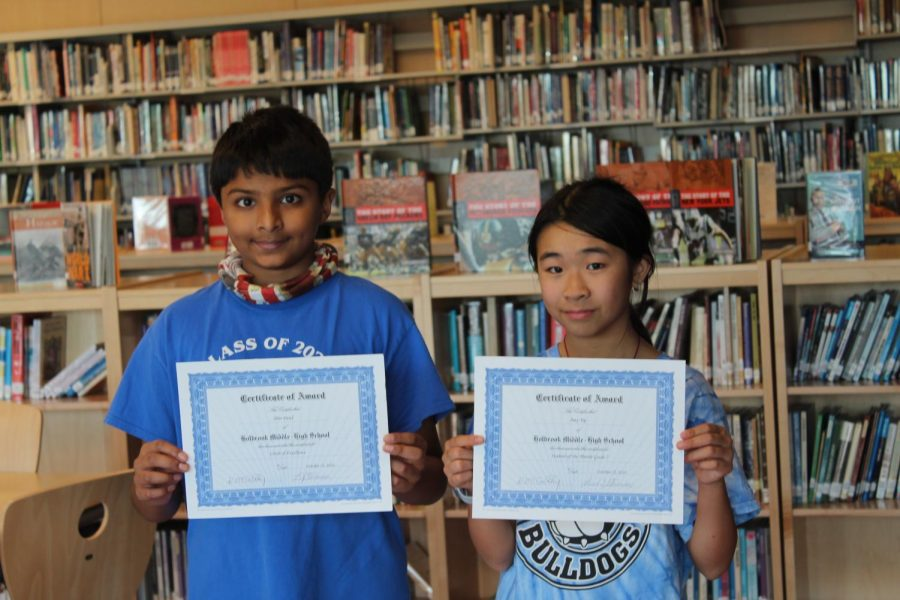 Amy Yip and Dhir Patel with the students of the month and circle of excellent.