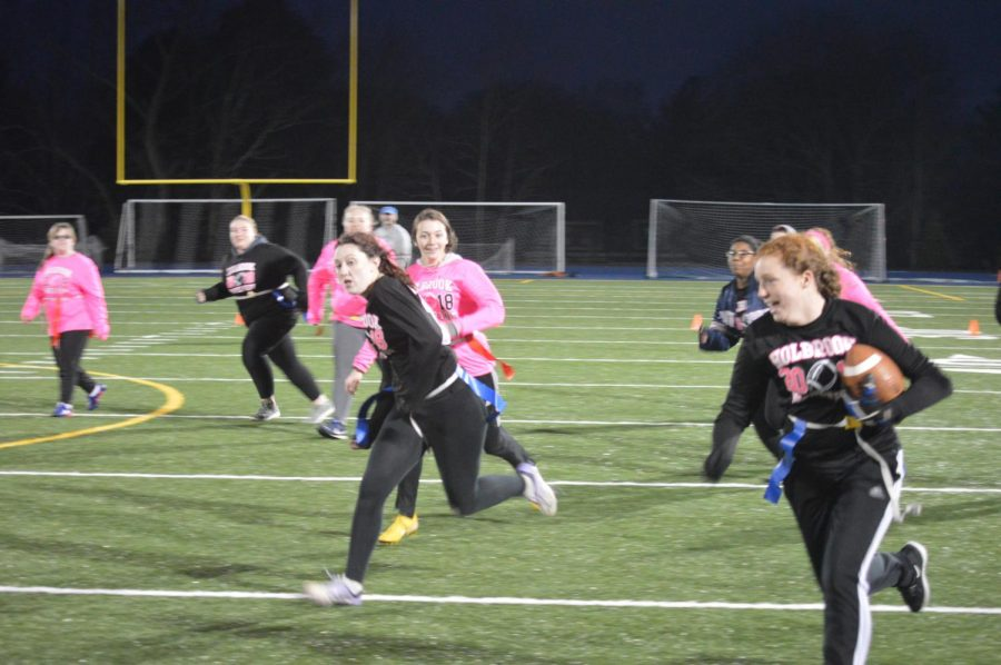 Katelin Andrews runs with the ball