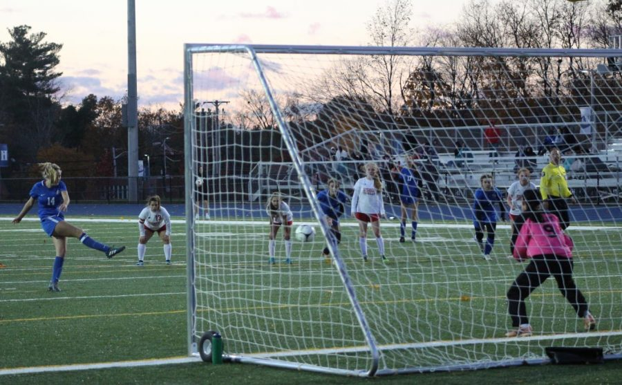 Riley Cochran takes a penalty kick in the second half