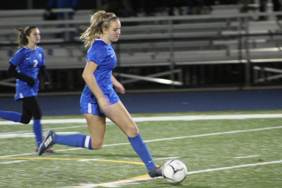 Riley Cochran advances the ball