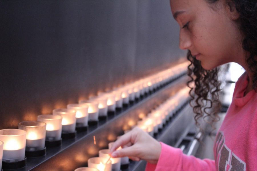Tiana Docanto lights a candle at the Unites States Holocaust Memorial Museum