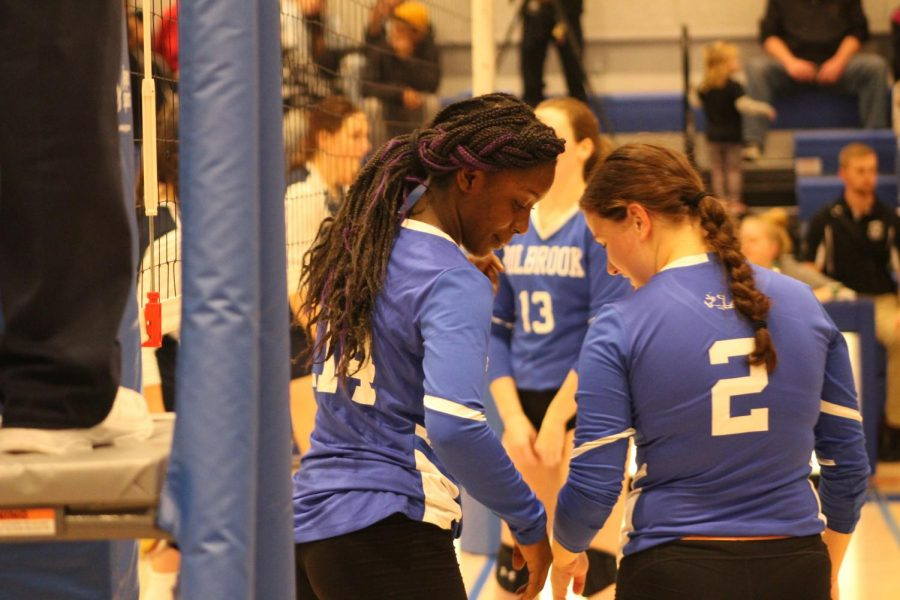 Monica Polycarpe and Kerry Walker get lined up before a point