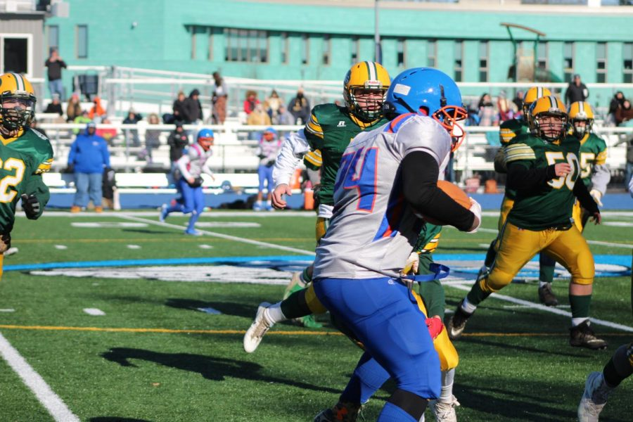 A Holbrook-Avon player with the ball
