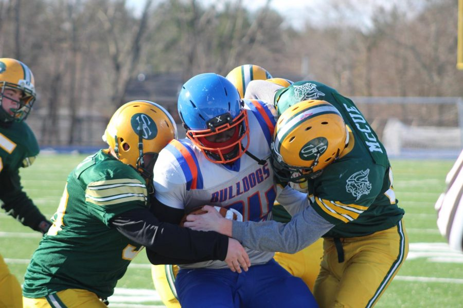 Captain Rahsai Banks-Lee tries to break free from multiple tacklers