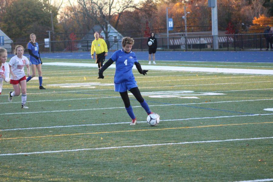 Sarah Sullivan controls the ball