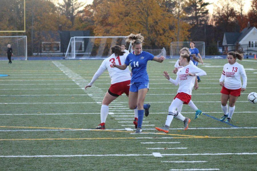 Riley Cochran tries to get past defenders