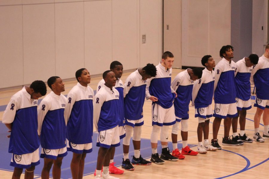 Team lines up for national anthem.