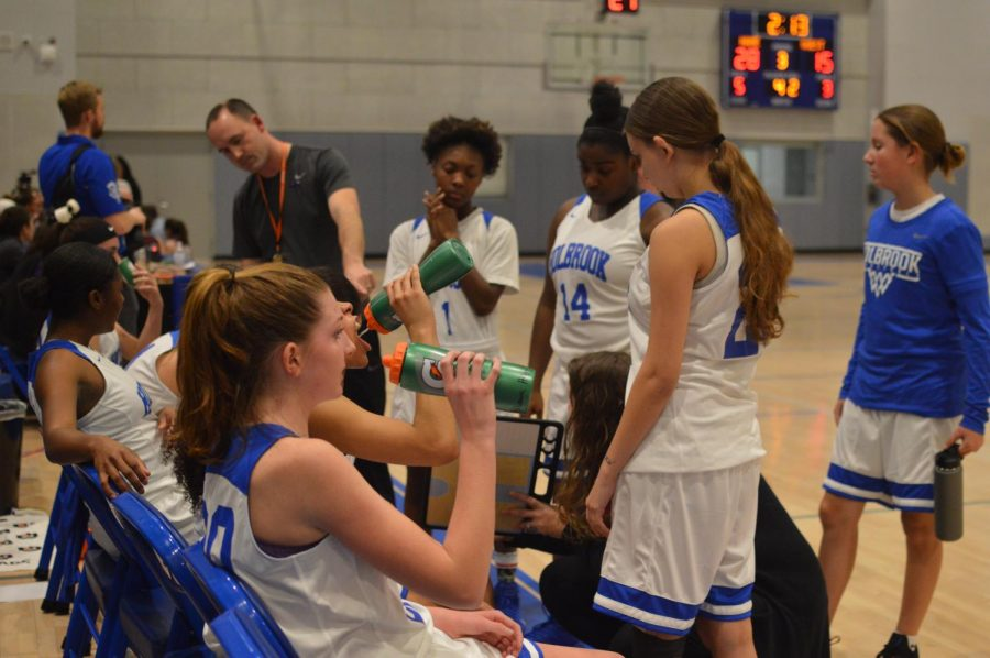 The girls team on the bench