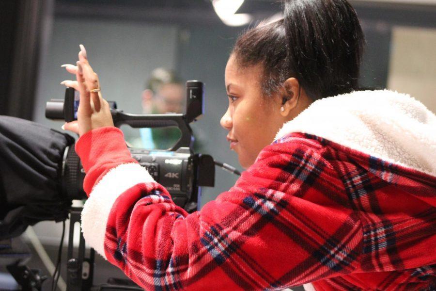 Kerrington Andrade adjusting the camera for the next shoot.