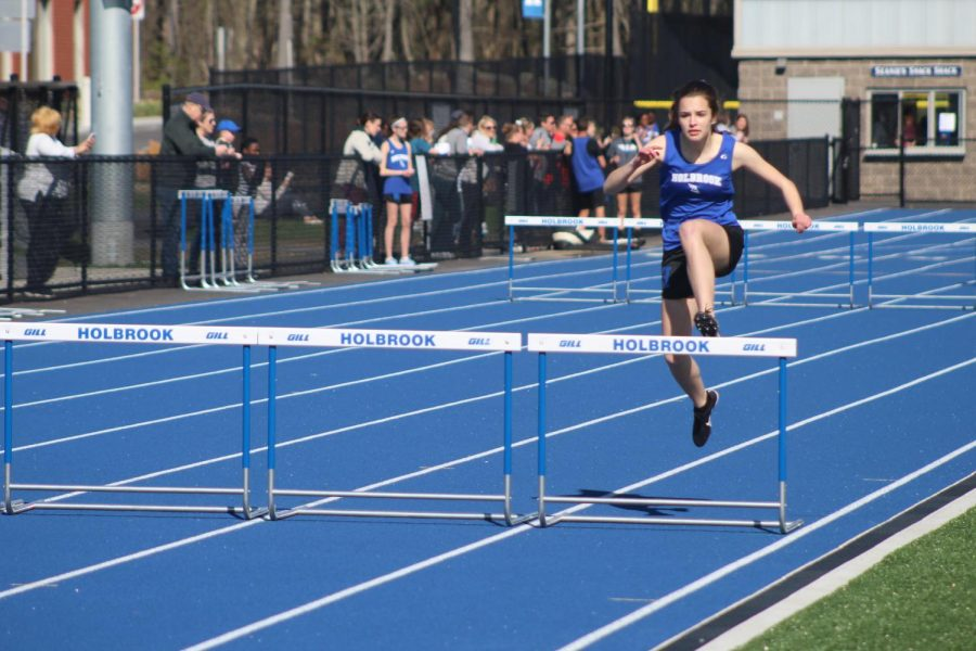 Cailey Mingolla goes over the last hurdle in her win in the 400 meter hurdles.