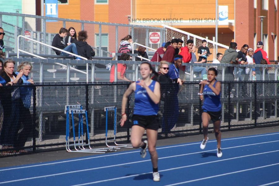 Lucy Ambroult takes the win in the 100 meters