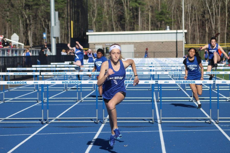Ruby Ambroult finishes the 100 meter hurdles