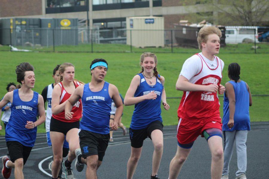 Nick  Miller, Nick Cioffi, and Bridget Moore running the 800 meter