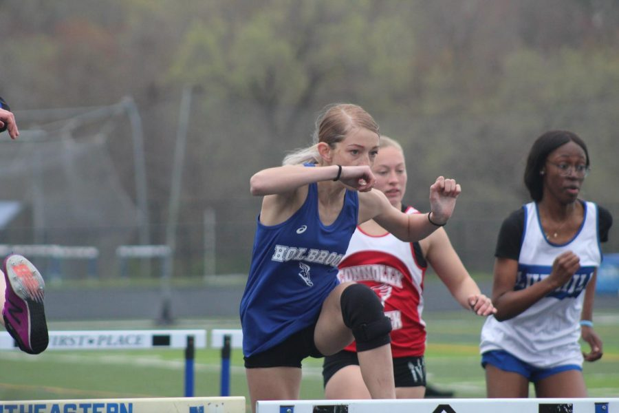 Ruby  Ambroult in the 100 meter hurdles