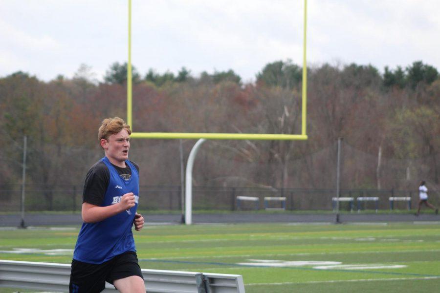 Jack Poppenga running the mile
