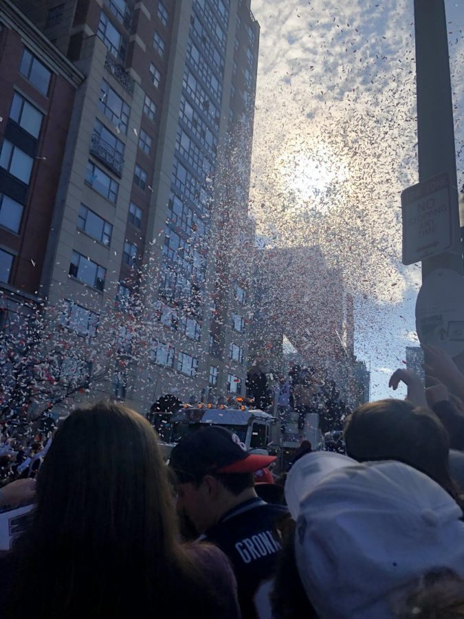 Confetti falls during the parade