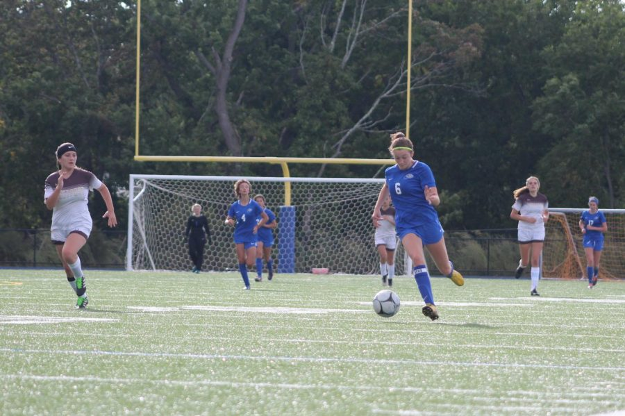 Lucy Ambroult brings the ball upfield