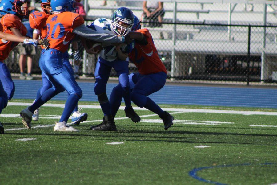 Two Holbrook defenders make a tackle
