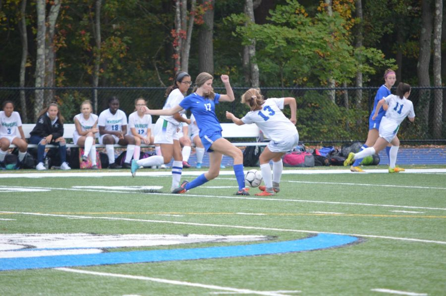 Emily Cochran faces Blue Hills player.