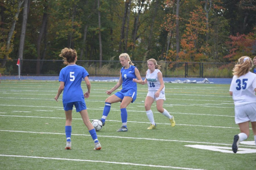 Riley Cochran gets ball past opponent.