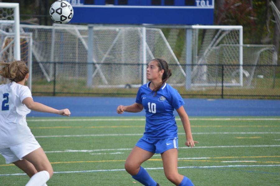 Emma Pepe  goes to head the ball.