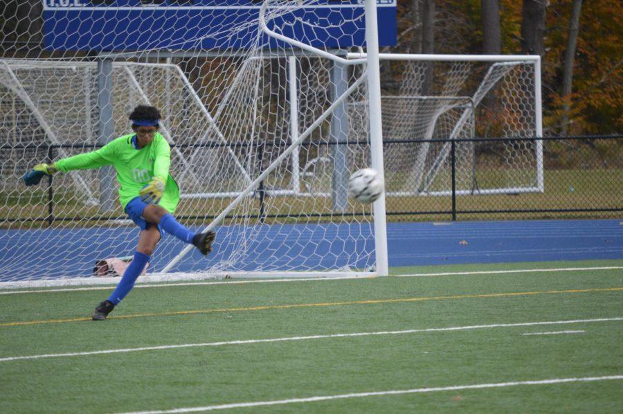 The goal keeper kicks the ball