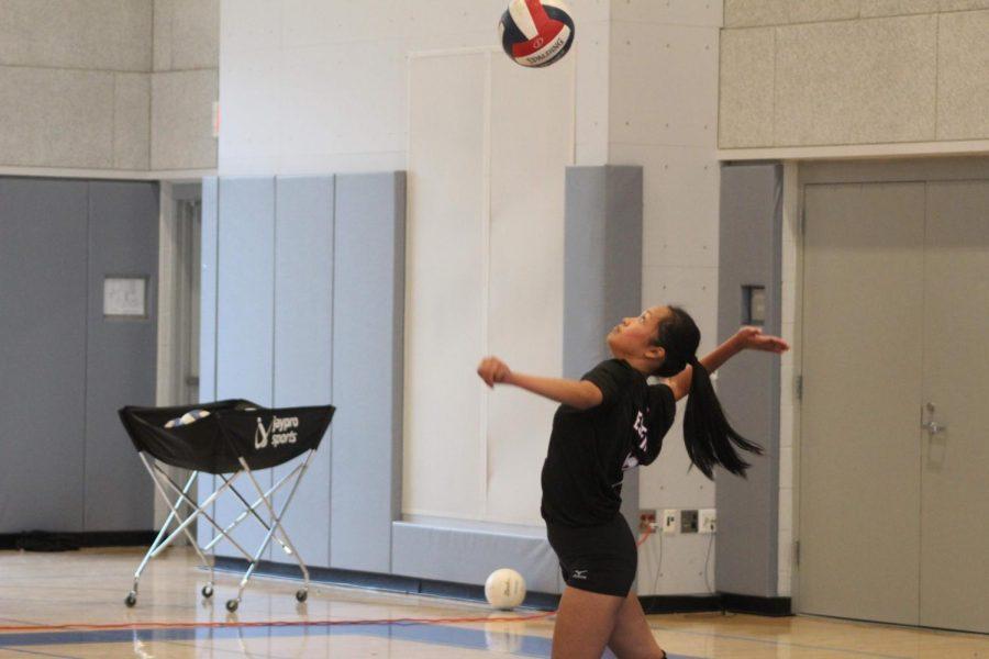 Shannon Esperon serves the ball.