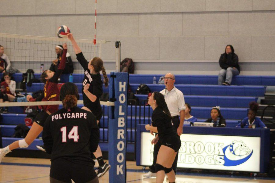 Brianna Sullivan taps ball over the net.