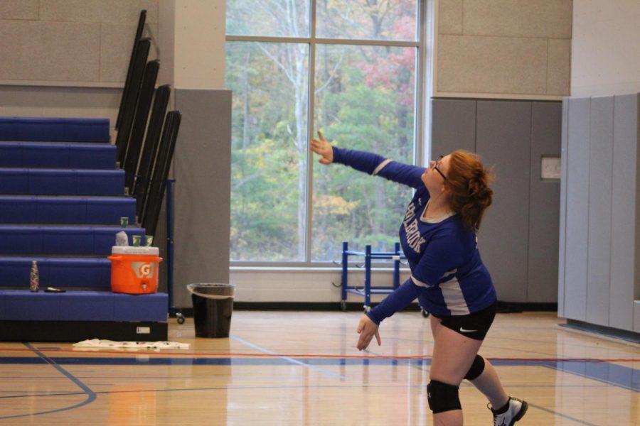 Kailey Hixon serves the ball.