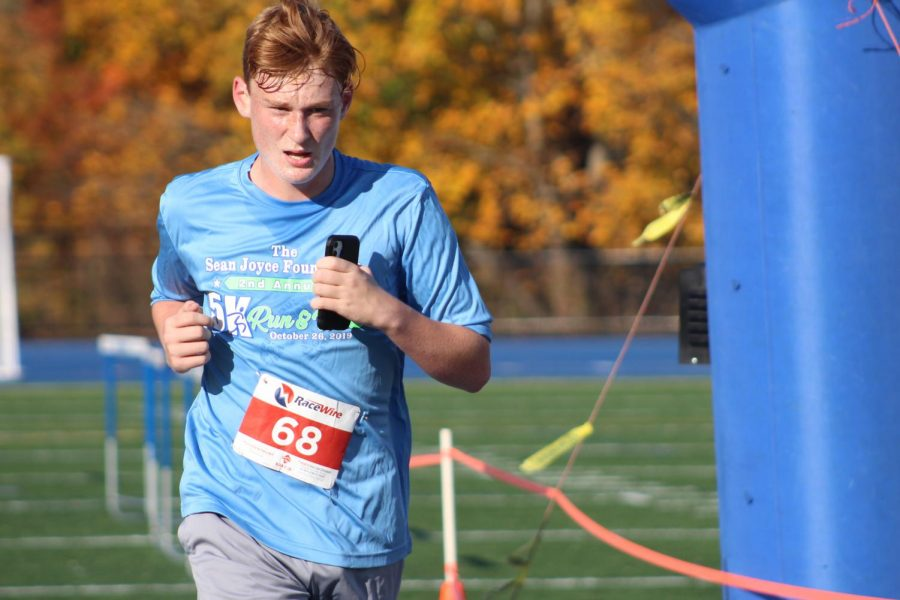 Jack Poppenga completing the 5K.