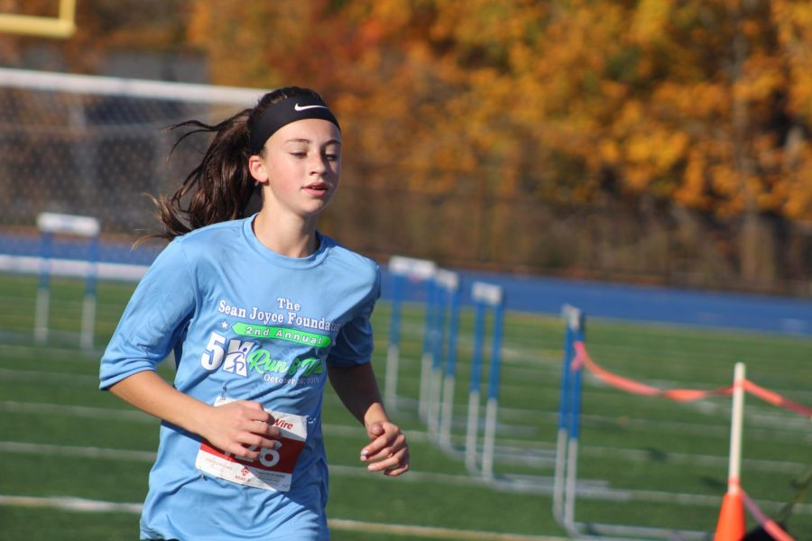 Taylor Dolan crossing the finish line.